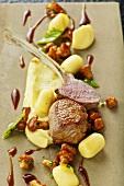 Roasted saddle of lamb with gnocchi, chanterelle mushrooms and mashed potato