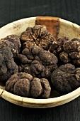 Perigod truffles in a wooden bowl