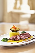 Saddle of venison with oranges, polenta and figs