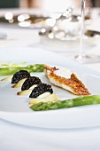 Red mullet fillet with fried onions, caviar and asparagus