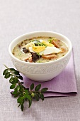 Zurek (Polish sour soup) with sausage and egg