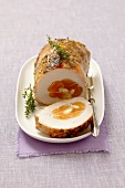 Stuffed roast pork with dried apricots and slivered almonds