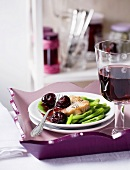 Veal steak with beans and cherry jam