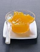 A small pot of mandarin jam