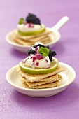 Crackers with sour cream, limes, onions and caviar