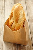 Two baguettes in a paper bag