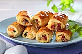 Puff pastry rolls with ham, cheese and salmon