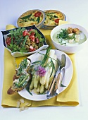 Asparagus dishes: crostini, salad, soup, tarts