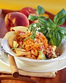 Carrot and peach salad with pine nuts and basil