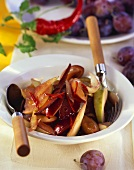 Plum and onion slices with strips of chilli