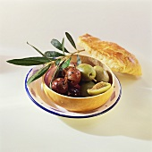 Marinated black and green olives and olive branch