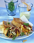 Pancake rolls filled with fennel and radicchio salad