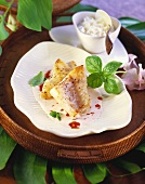 Redfish fillet with coconut sauce and basil