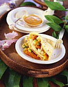Pancake with vegetable filling and sweet and sour sauce