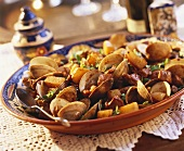 Clams with diced pork and potatoes (Portugal)