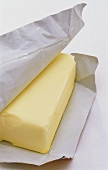 A block of butter wrapped in paper