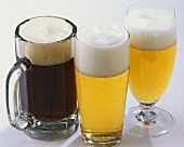 Three types of beer in glasses: Schwarzbier, Helles & Pils