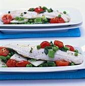 Fish fillets and vegetables baked in foil