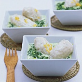 Fish dumplings in spinach cream sauce