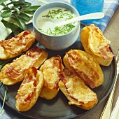 Baked potatoes with cheese and bacon topping