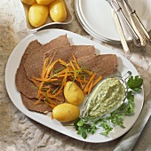 Boiled beef with carrots, potatoes and parsley & chervil sauce