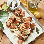 Raw mixed meat kebabs with onions and sage