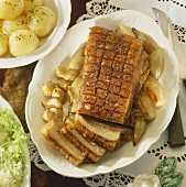 Roast pork with crackling and caraway