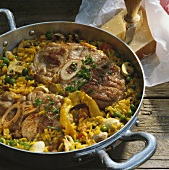 Braised slices of lamb shank with saffron vegetable rice