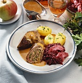 Beef roulade with red cabbage and potatoes