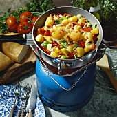 Fried potatoes, peppers and egg in a camping pan
