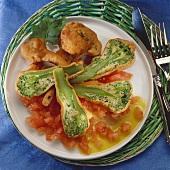 Deep-fried broccoli in wine batter on tomato salsa