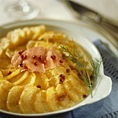Potato gratin with smoked salmon and red peppercorns
