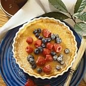 Lemon sour cream tart garnished with summer berries