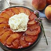 Peach Tarte Tatin with whipped cream