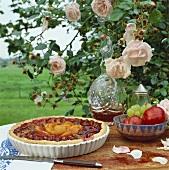 Round plum and peach tart