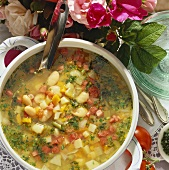 Mixed vegetable soup in a soup tureen