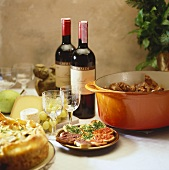 Crostini, vegetable quiche, venison ragout, cheese & wine