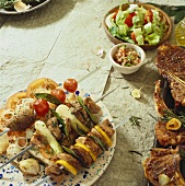 Grilled kebabs, meat and mixed salad