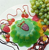 Green jelly decorated with sweets