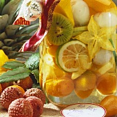 Rumtopf with exotic fruit in preserving jar
