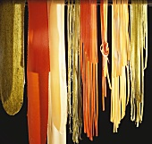Coloured pasta against black background