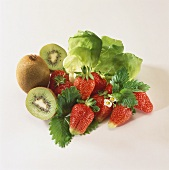 Fresh strawberries, kiwi fruits and lettuce leaves