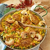 Paella with chicken, prawns and peas