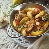 Lemon chicken with potatoes, tomatoes and rosemary