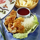 Prawns in batter with dip and deep-fried glass noodles