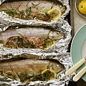 Trout with herbs and red onions, baked in foil