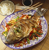 Fried carp with Asian vegetables, soy sauce and rice