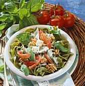 Green pasta with Gorgonzola sauce, tomatoes and walnuts