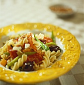 Pasta with mixed vegetables, sheep's cheese and pine nuts