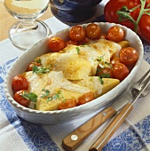 Baked polenta slices with cherry tomatoes and cheese